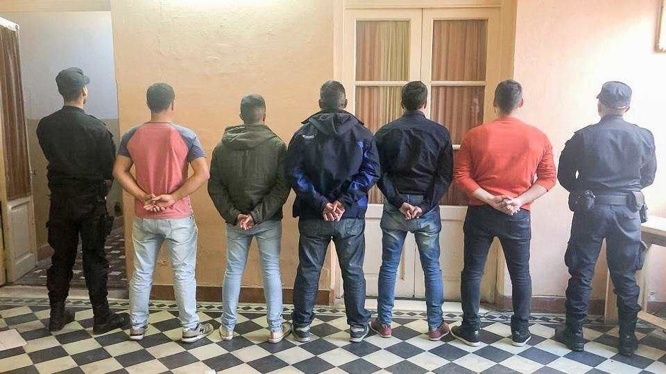 Cinco de los ocho policías detenidos por la masacre.